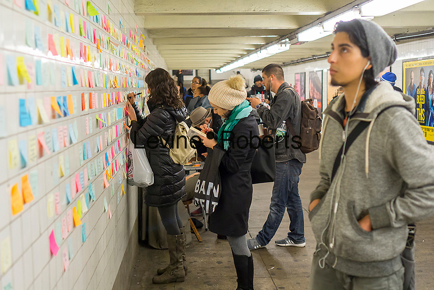 """Thousands of travelers write their thoughts about the results of the presidential election on post-it notes as part of the """"Subway Therapy"""" project by Matthew Chavez in the subway in New York, seen on Tuesday, November 15, 2016. Chavez started the project to enable New Yorkers to vent their emotions on the election of Donald Trump. Many wrote angry messages and some wrote messages of hope and some now felt they were not alone and part of a community. (© Richard B. Levine)"""