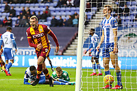 Charlie Wyke of Bradford City celebrates scoring the first goal of the game during the Sky Bet League 1 match between Wigan Athletic and Bradford City at the DW Stadium, Wigan, England on 18 November 2017. Photo by Thomas Gadd.