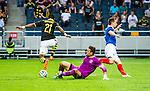 Solna 2014-07-24 Fotboll Europa League AIK - Linfield FC :  <br /> AIK:s Kennedy Igboananike rundar Linfields m&aring;lvakt goalkeeper Jonny Tuffey innan han g&ouml;r 1-0 till AIK<br /> (Foto: Kenta J&ouml;nsson) Nyckelord:  AIK Gnaget Friends Arena Linfield LFC Europa League Kval