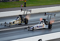Jun. 16, 2012; Bristol, TN, USA: NHRA top fuel dragster driver Antron Brown (right) races alongside Tony Schumacher during qualifying for the Thunder Valley Nationals at Bristol Dragway. Mandatory Credit: Mark J. Rebilas-