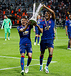 Jesse Lingard of Manchester United and Marcus Rashford celebrate with the trophy after the UEFA Europa League Final match at the Friends Arena, Stockholm. Picture date: May 24th, 2017.Picture credit should read: Matt McNulty/Sportimage