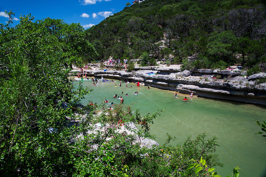Bull Creek District Park watershed includes limestone seeps, springs, and waterways; scenic cliffs and waterfalls; interesting archaeological and cultural features that make up for this popular swimming hole - Stock Image