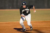 Ryan Semeniuk #26 of the Wake Forest Demon Deacons takes off on a steal of third base against the Xavier Musketeers at the Wake Forest Baseball Park March 6, 2010, in Winston-Salem, NC.  Photo by Brian Westerholt / Four Seam Images