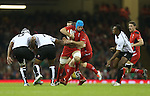 Wales flanker Justin Tipuric cuts inside his opposite number Akapusi Qera.<br /> Dove Men Series 2014<br /> Wales v Fiji<br /> Millennium Stadium<br /> 15.11.14<br /> &copy;Steve Pope-SPORTINGWALES