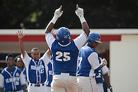 13 July 2010: Eleonar Pinto of Team Saint Martin celebrates after a solo home run during day 1 of the Open de Rouen, an international tournament with Team France, Team Saint Martin, Team All Star Elite, at Stade Pierre Rolland, in Rouen, France.