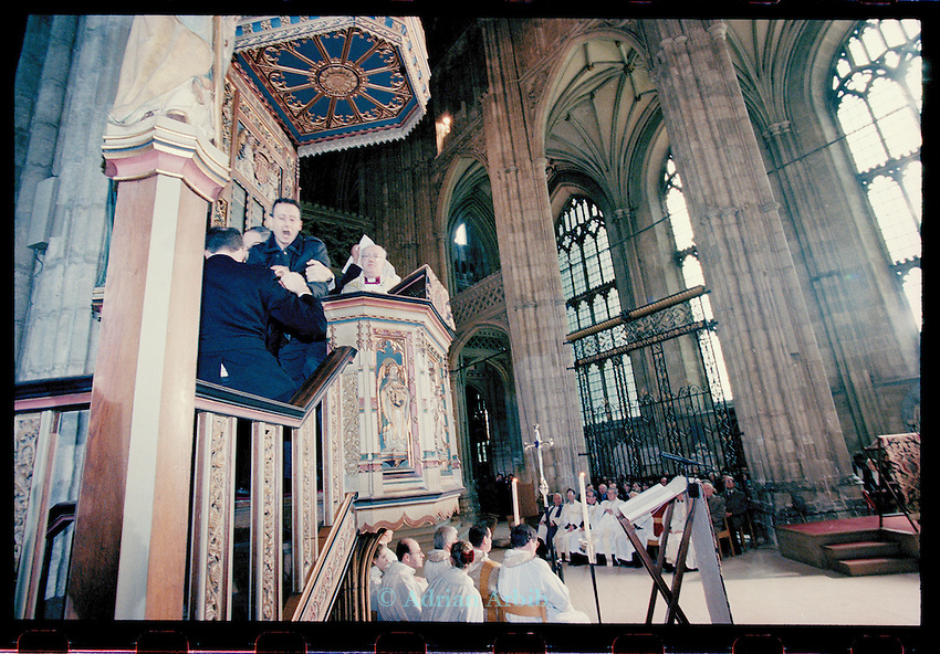Peter Tatchell and other Gay rights activists from 'Outrage'  occupy the pulpit at Canterbury Cathedral, during Archbishop Carey's Easter sermon,  April 1998. to protest against the Church's views on same sex marriage