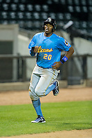 Rashad Crawford (20) of the Myrtle Beach Pelicans hustles towards home plate against the Winston-Salem Dash at BB&T Ballpark on April 18, 2016 in Winston-Salem, North Carolina.  The Pelicans defeated the Dash 6-4.  (Brian Westerholt/Four Seam Images)
