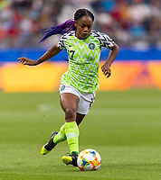 REIMS, FRANCE - JUNE 08: Francisca Ordega #17 dribbles the ball during a game between Norway and Nigeria at Stade Auguste-Delaune on June 8, 2019 in Reims, France.