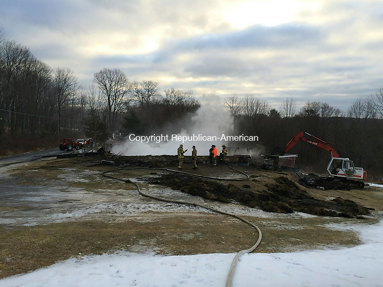 TORRINGTON, CT- 20 January 2015- 012015BJ01-- A fire that destroyed a 77-year-old barn still smoldered after bring extinguished by firefighters Tuesday morning. One llama in the barn died, according to firefighters and the farm owners, the Bottass family. Bruno Matarazzo Jr. Republican-American