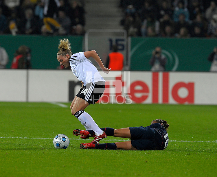 Carli Lloyd slide tackles Kim Kulig. US Women's National Team defeated Germany 1-0 at Impuls Arena in Augsburg, Germany on October 27, 2009.