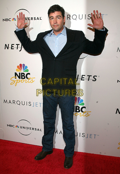 KYLE CHANDLER .NBC Universal Pre-Superbowl Party held at Loew's Portifino Bay Hotel, Orlando, Florida, USA, .31st January, 2009..full length black suit jacket blazer blue jeans hands funny .CAP/ADM/RR.©Randi Radclif/Admedia/Capital Pictures