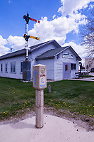 Lincoln Highway marker in front of the Columbo Hall on Front Street in Evanston, Wyoming.