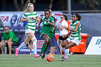 8 November 2015:  Marshall Forward Sydney Arnold (9) advances the ball around North Texas Defender Chelsei Soto (18) in the first half as the Marshall University Thundering Herd faced the University of North Texas Mean Green in the Conference USA championship game at University Park Stadium in Miami, Florida.