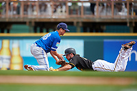 Toronto Blue Jays second baseman Darwin Barney (18) can not come up with the throw as Matt Joyce (67) slides in during a Spring Training game against the Pittsburgh Pirates on March 3, 2016 at McKechnie Field in Bradenton, Florida.  Toronto defeated Pittsburgh 10-8.  (Mike Janes/Four Seam Images)