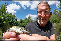 BNPS.co.uk (01202 558833)<br /> Pic:   JackPerks/BNPS<br /> <br /> Angler Mat Faulkner has hit the big time after breaking the record for catching the largest tiddler fish in Britain.<br /> <br /> Mat landed the enormous stickleback after it went for his bait of a tiny red maggot.<br /> <br /> The 41-year-old barely noticed his his rod flex as he hooked the three-spined stickleback.<br /> <br /> The 3ins long 'monster' weighed 9 grammes - almost 2 grammes heavier than the existing record that has stood for over 20 years.