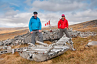 "Pictured: Dr Peter Pare (L) with his wife by the wreckage of the Wellington Bomber MF509 in the Brecon Beacons, Wales, UK. <br /> Re: The nephew of a World War II airman whose plane crashed into a Welsh mountain has climbed the peak to pay tribute to the uncle he never met.<br /> Dr Peter Paré, 74, travelled from his home in Vancouver, Canada, to read a poem at the desolate spot where his uncle Bill Allison was killed.<br /> Flying officer Allison, 28, was one of the six crew of a Wellington Bomber that crashed on a training flight in November 1944.<br /> The plane wreckage is still scattered over Carreg Goch in the Brecon Beacons where hundreds of young airmen learned to prepare for bombing missions.<br /> Dr Paré said: ""I wanted to make this pilgrimage even though I was a baby when he died and never met Bill Allison.<br /> ""We only found out about the crash site recently and it is remarkable that so much of the plane is still here.""<br /> Flying officer Allison was the oldest on board when the plane's starboard engine developed a fault during a low-flying exercise.<br /> For years local people have honoured the brave airmen by flying a Canadian flag at the scene - replacing it every time it gets ripped by strong winds.<br /> Dr Paré, retired Professor of Medicine at the University of British Columbia, said: ""It was very moving to see the Maple Leaf flying where my uncle died all those years ago.<br /> ""It brought a tear to my eye as I read the poem I wrote in his honour."""