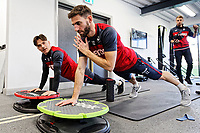 SWANSEA, WALES - JANUARY 25:(L-R) Roque Mesa and Angel Rangel exercise in the gym during the Swansea City Training and Press Conference at The Fairwood Training Ground, Swansea, Wales, UK. Thursday 25 January 2018