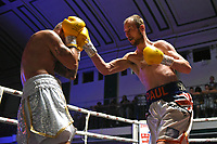 Paul Cummings (white/blue shorts) defeats Kieran Joseph during a Boxing Show at York Hall on 29th June 2019