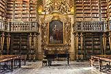 PORTUGAL, Coimbra, Inside Biblioteca Joanina's main hall with piano and Gold decorated book shelves
