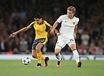 Arsenal's Alexis Sanchez tussles with Basel's Alexander Fransson during the Champions League group A match at the Emirates Stadium, London. Picture date September 28th, 2016 Pic David Klein/Sportimage