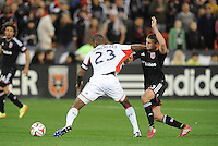 Washington D.C. - April 5, 2014: Jose Goncalves from the New England Revolution shields the ball against Perry Kitchen of D.C. United.  D.C. United defeated 2-0 the New England Revolution during a Major League Soccer match for the 2014 season at RFK Stadium.