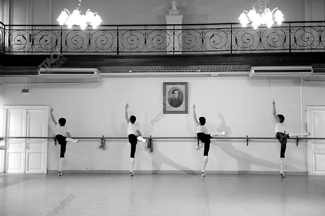 Boys from the eighth year at the Vaganova Ballet Academy in St. Petersburg worked at the bar below the portrait of Agrippina Vaganova during a daily class. March 19, 2009