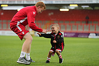 A young Stevenage mascot enjoys the match day experience prior to kick-off during Stevenage vs Norwich City, Friendly Match Football at the Lamex Stadium on 11th July 2017