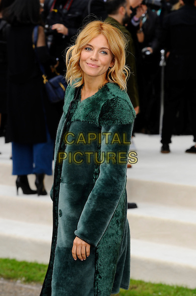 LONDON, ENGLAND - SEPTEMBER 21:  Sienna Miller attending the Burberry Prorsum Spring/Summer 2016 show during London Fashion Week at Kensington Gardens, on September 21, 2015 in London, England.<br /> CAP/MAR<br /> &copy; Martin Harris/Capital Pictures