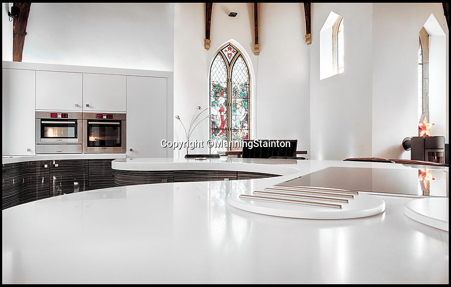 BNPS.co.uk (01202 558833)Pic: ManningStainton/BNPS<br /> <br /> All White Now - This former church has had a stunning all white makeover.<br /> <br /> A 157-year-old church that has been converted into a divine home could be the answer to homebuyers' prayers - if they have £750,000 to spare.<br /> <br /> The stunning Churchfield House was originally Pudsey Unitarian Chapel but was converted into a stylish high-spec home six years ago.<br /> <br /> The new owners will get all the modern conveniences they could want, such as underfloor heating and an integrated sound system, while keeping the beautiful original character features, like the stained glass windows and dramatic arched roof beams.<br /> <br /> The heavenly property in Pudsey, Leeds, is on the market with estate agents Manning Stainton.