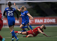 Seattle, WA - Saturday, May 14, 2016: Portland Thorns FC midfielder Lindsey Horan (7) slide tackles Seattle Reign FC midfielder Kim Little (8) during the second half. The Portland Thorns FC and the Seattle Reign FC played to a 1-1 tie during a regular season National Women's Soccer League (NWSL) match at Memorial Stadium.