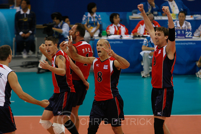 USA's  Richard Lambourne, #5,  Riley Salmon, #10, Lloy Ball, #1, William Priddy, #8, and Ryan Millar, #9 celebrate after winning a game during the quarterfinals match at the Capital Gymnasium in Beijing, Wednesday, August 20, 2008. USA defeated Serbia 3-2. Millar, 30-year-old Highland resident and former Brigham Young All-American and coach, is making his third Olympic appearance at the Beijing Games. Lambourne also went to BYU...Chris Detrick/The Salt Lake Tribune.