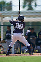GCL Yankees 2 shortstop Yancarlos Baez (68) at bat during the first game of a doubleheader against the GCL Pirates on July 31, 2015 at the Pirate City in Bradenton, Florida.  GCL Pirates defeated the GCL Yankees 2 2-1.  (Mike Janes/Four Seam Images)