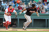 Infielder Cleuluis Rondon (5) of the Kannapolis Intimidators bats in a game against the Greenville Drive on Friday, April 11, 2014, at Fluor Field at the West End in Greenville, South Carolina. The Greenville catcher is Jake Romanski. Rondon is the No. 26 prospect of the Chicago White Sox, according to Baseball America.  (Tom Priddy/Four Seam Images)
