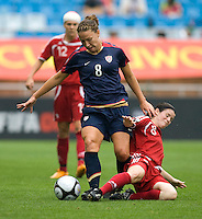 Canada's (8) Diana Matheson tries to tackle the ball away from USWNT forward (8) Lauren Cheney during the finals of the Peace Queen Cup.  The USWNT defeated Canada, 1-0, at Suwon World Cup Stadium in Suwon, South Korea.