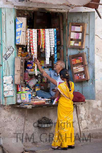 Young Indian woman out shopping in old town Udaipur, Rajasthan, Western India