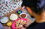 Expatriate Palestinians break their fast during the holy fasting month of Ramadan at their residence in Istanbul, Turkey, on April 30, 2020. Photo by Mahmoud abu Salama