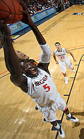 Jan. 27, 2011; Charlottesville, VA, USA; Virginia Cavaliers center Assane Sene (5) grabs a rebound during the game against the Maryland Terrapins at the John Paul Jones Arena. Maryland won 66-42. Mandatory Credit: Andrew Shurtleff