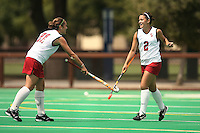 STANFORD, CA - AUGUST 19:  Stephanie Byrne congratulates Bailey Richardson of the Stanford Cardinal during Stanford's 4-1 exhibition win over the University of the Pacific on August 19, 2008 at the Varsity Field Turf in Stanford, California.