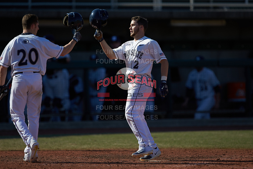 Conlin Hughes (2) of the Penn State Nittany Lions celebrates a home run with Mason Nadeau (20) against the Xavier Musketeers at Coleman Field at the USA Baseball National Training Center on February 25, 2017 in Cary, North Carolina. The Musketeers defeated the Nittany Lions 10-4 in game one of a double header. (Brian Westerholt/Four Seam Images)