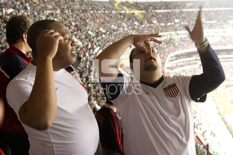 USA fans respond to heckling by Mexican fans outside the American supporters section protected by Mexican police at Azteca stadium before the USA vs. Mexico World Cup Qualifier in Mexico City, Mexico on March 26, 2013.