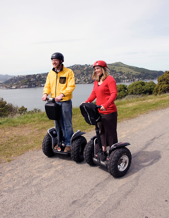 California, San Francisco: Couple on Segways on Angel Island on San Francisco Bay, model released..Photo #: 15-casanfcamari213-70405.Photo © Lee Foster 2008