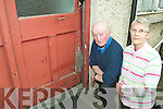 WHAT A STATE: Paul and Margaret O'Brien from Spa Road are angry that their windows and doors have been left to rot by the council.