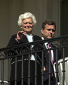 Washington, D.C. - November 2, 2005 -- Former first lady Barbara Bush waves to her son, United States President George W. Bush, prior to the arrival of Charles, the Prince of Wales and Camilla, the Duchess of Cornwall to the White House for a luncheon in Washington, D.C. on November 2, 2005.  Marvin P. Bush, the President's brother, looks on..Credit: Ron Sachs / CNP.(Restriction: No New York Metro or other Newspapers within a 75 mile radius of New York City)