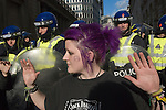 Stop the City march and demonstration against capitalism April1st City of London while G20 World Leaders Summit meet in London. 2009. Anarchist  punk woman and police.