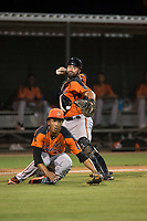 AZL Giants Orange catcher Fabian Pena (14) prepares to make a throw to first base over the head of starting pitcher Francis Pena (87) during an Arizona League game against the AZL Athletics at Lew Wolff Training Complex on June 25, 2018 in Mesa, Arizona. AZL Giants Orange defeated the AZL Athletics 7-5. (Zachary Lucy/Four Seam Images)