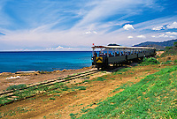 Tourists enjoy a ride on the Historic Old Hawaiian Railway. Tours leave the town of Ewa Beach and go up the Leeward Oahu coast to Kahe Point. Tours last about and hour and a half.