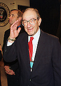 Federal Reserve Chairman Alan Greenspan offers a wave or salute prior to witnessing the signing of S.900, the Financial Services Modernization Act of 1999 on 12 November, 1999 in Washington, DC.  This act replaces the depression-era Glass-Stegall Act.<br /> Credit: Ron Sachs / CNP