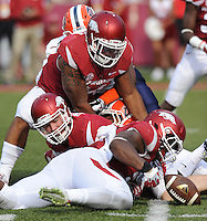 NWA Democrat-Gazette/ANDY SHUPE<br /> Arkansas' Josh Williams (bottom) reaches to recover the ball after a botched punt in front of Drew Gorton against the University of Texas at El Paso Saturday, Sept. 5, 2015, during the fourth quarter of play in Razorback Stadium in Fayetteville. Visit nwadg.com/photos to see more from the game.