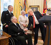 U.S. President Donald J. Trump shakes the hand of Lauren Bruner while visiting with survivors from the USS Arizona at The White House in Washington, DC, July 21, 2017. <br /> Credit: Chris Kleponis / Pool via CNP