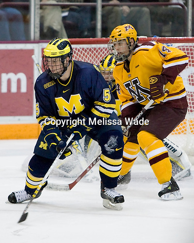 Steven Kampfer's Michigan Wolverines were defeated 8-2 by the Minnesota Golden Gophers in the College Hockey Showcase on November 25, 2006 at Mariucci Arena in Minneapolis, Minnesota. (Michigan goalie - Billy Sauer, Minnesota forward Justin Bostrom)